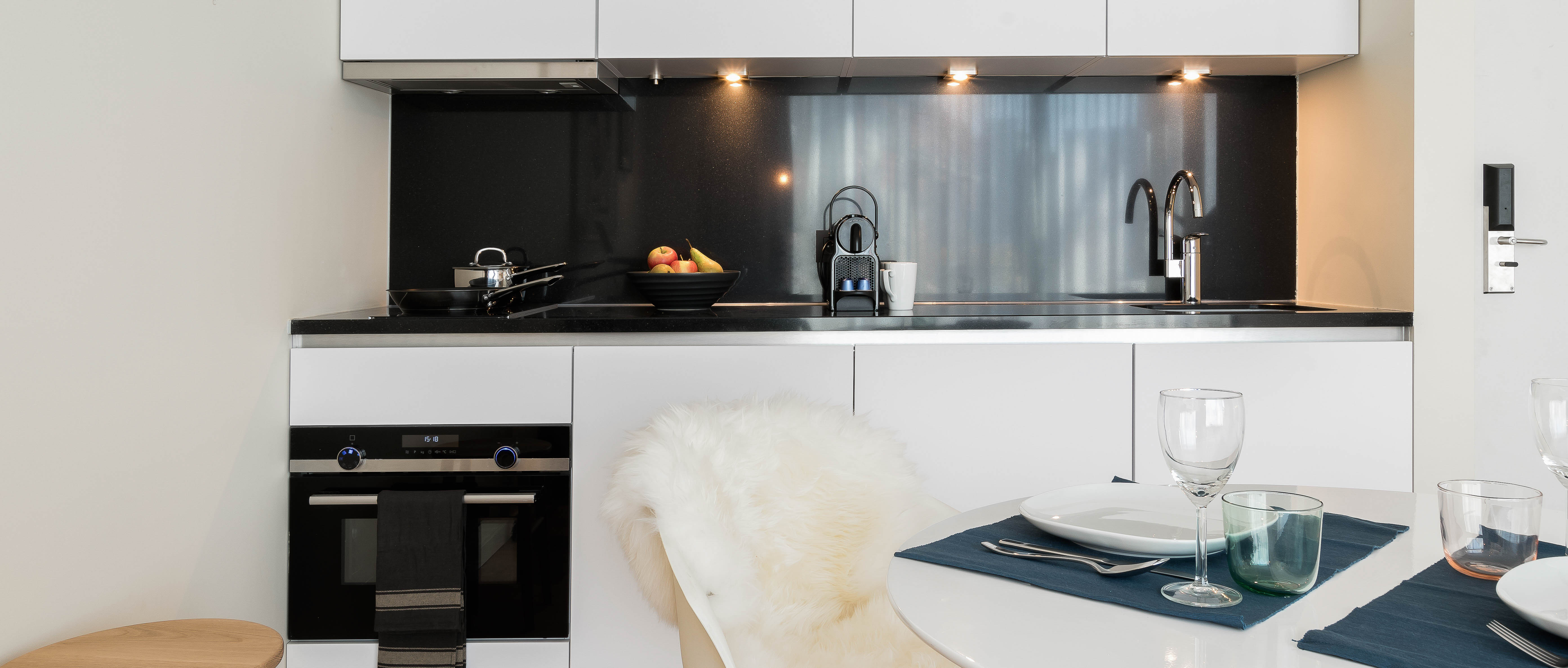 Modern kitchen and dining set up PREMIER SUITES Antwerp